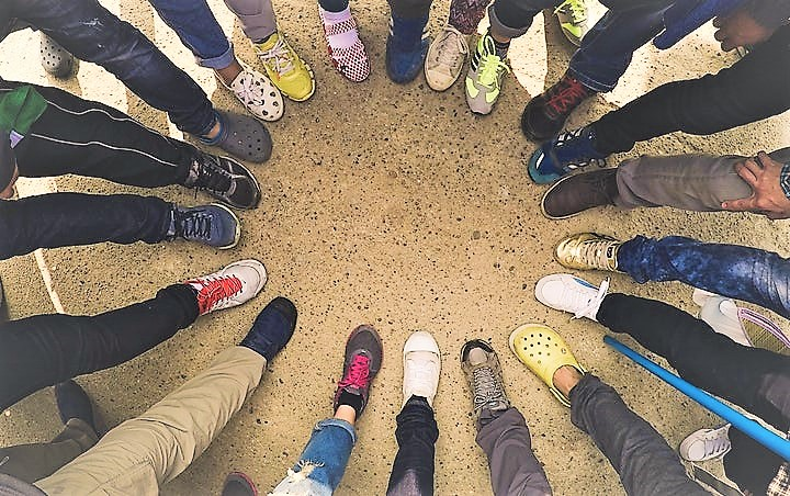 Circle of people with different shoes all pointing their feet inward together to represent diversity. Clikc the image or read on to find out more about what YellowDogs founder, Gareth Williams, thinks about diversity at YellowDog.